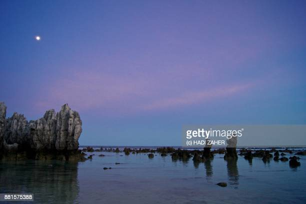 sunset sky and the full moon | nauru - nauru stock pictures, royalty-free photos & images