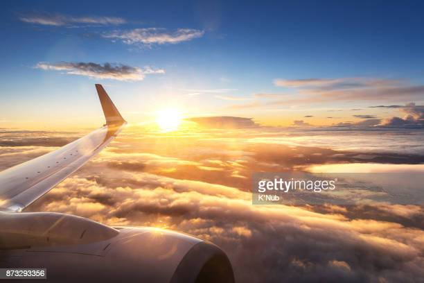 Sunset sky on airplane window over Copenhagen, Denmark in Friday evening flight