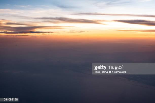 Sunset sky on Java Sea and South Sumatra in Indonesia aerial view from airplane