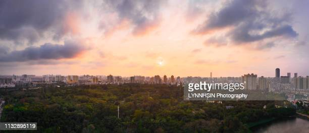 sunset skyline of forest city haikou - lynnhsin stock pictures, royalty-free photos & images
