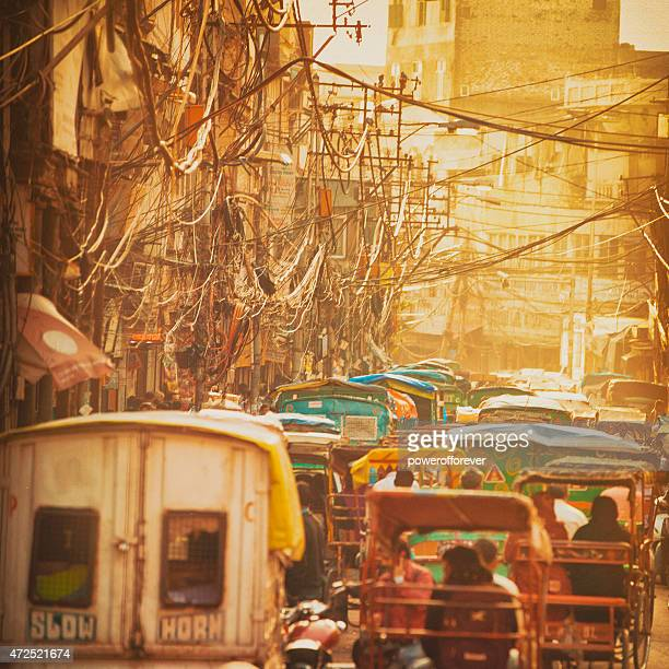 sunset street in old delhi, india - delhi stock pictures, royalty-free photos & images