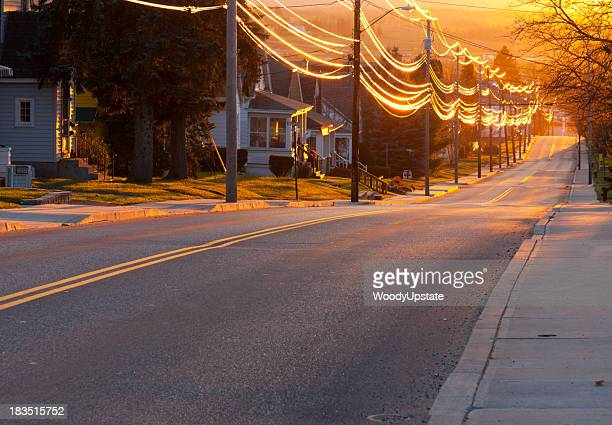 sunset street - electricity stock pictures, royalty-free photos & images