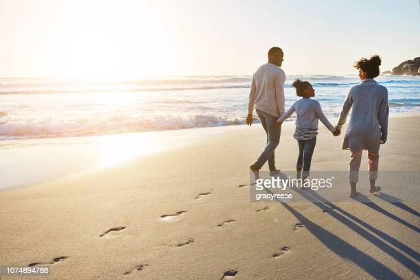 sunset strolls on the beach with the fam - footprint stock pictures, royalty-free photos & images