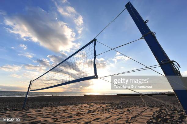 Sunset sunbeam on Izu Peninsula and Sagami Bay, Northern Pacific Ocean, and beach volleyball court on Kugenuma Beach in Fujisawa city in Kanagawa prefecture in Japan