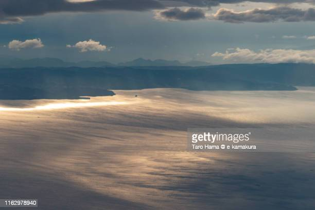sunset sunbeam on mountain and sea in japan sunset time aerial view from airplane - taro hama ストックフォトと画像