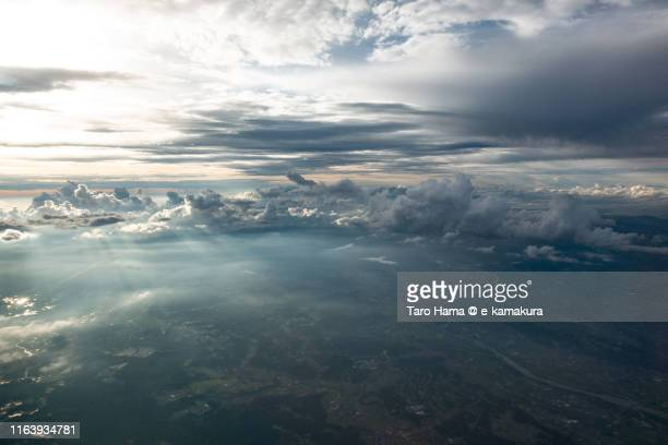 sunset sunbeam on mountain in japan daytime aerial view from airplane - taro hama ストックフォトと画像