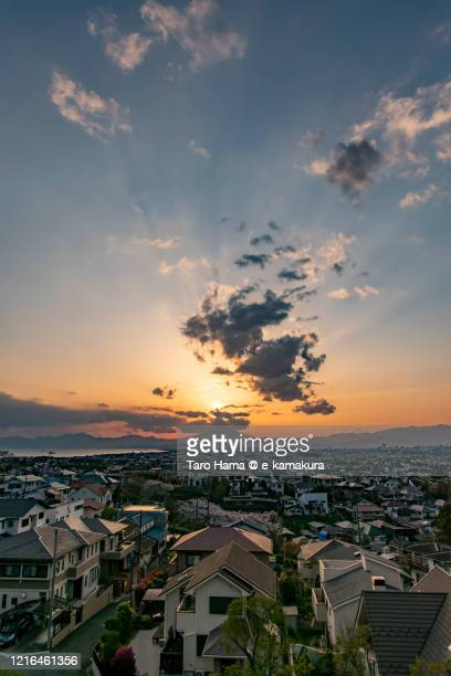 sunset sunbeam on mt. fuji and the residential district by the sea in kanagawa prefecture of japan - chigasaki stock pictures, royalty-free photos & images