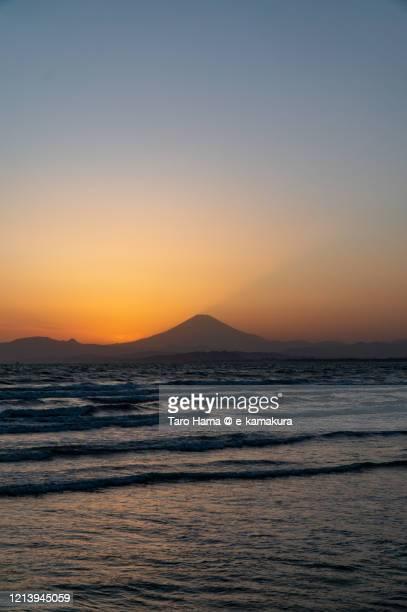 sunset sunbeam on mt. fuji in kanagawa prefecture of japan - kanagawa prefecture stock pictures, royalty-free photos & images