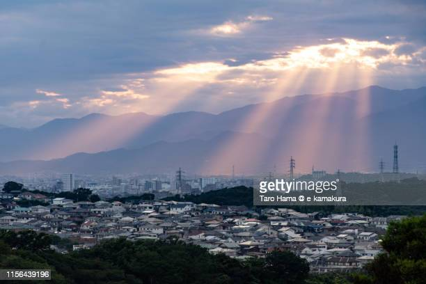 sunset sunbeam on residential district and mountains in japan - chigasaki stock pictures, royalty-free photos & images