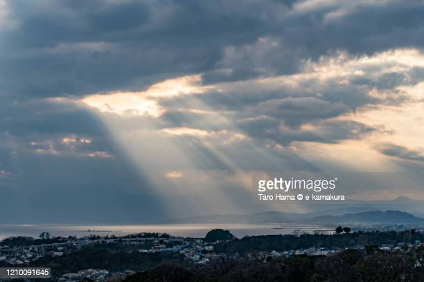 sunset sunbeam on residential district by the beach in kanagawa prefecture of japan - 自然 ストックフォトと画像