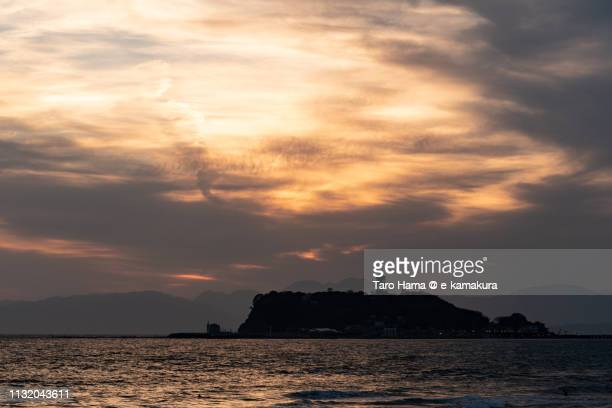 Sunset sunbeam on Sagami Bay (Pacific Ocean) and Enoshima Island in Fujisawa city in Japan