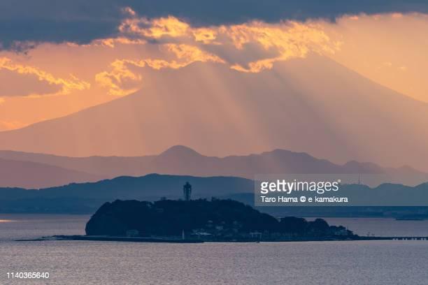 Sunset sunbeam on snow-capped Mt. Fuji in Japan