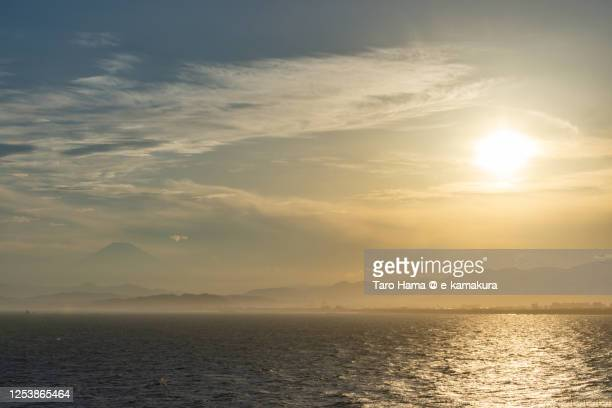 sunset sunbeam on the beach and mt. fuji in kanagawa prefecture of japan - taro hama ストックフォトと画像