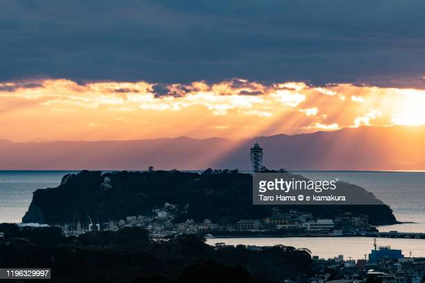 sunset sunbeam on the beach in kanagawa prefecture of japan - angel island stock photos and pictures