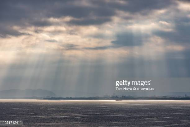 sunset sunbeam on the beach in kanagawa prefecture of japan - taro hama ストックフォトと画像
