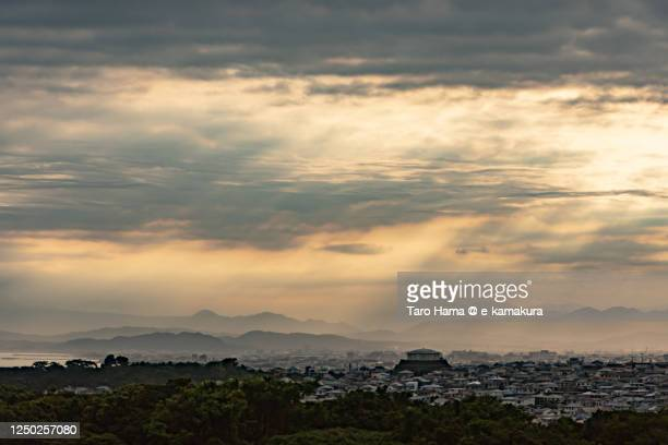 sunset sunbeam on the residential district by the beach in kanagawa prefecture of japan - taro hama ストックフォトと画像