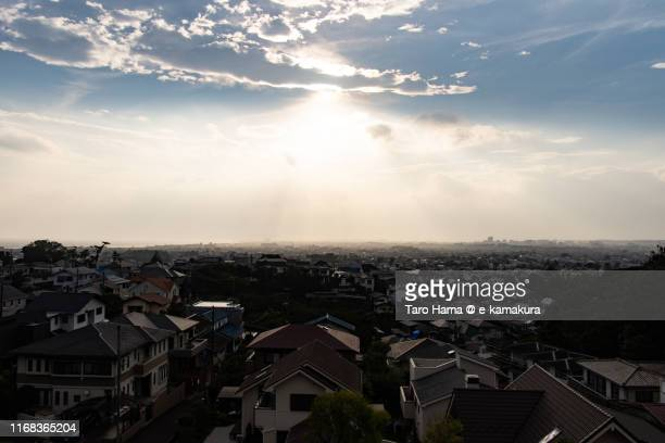 sunset sunbeam on the residential district by the sea in fujisawa and chigasaki cities of kanagawa prefecture, japan - chigasaki stock pictures, royalty-free photos & images