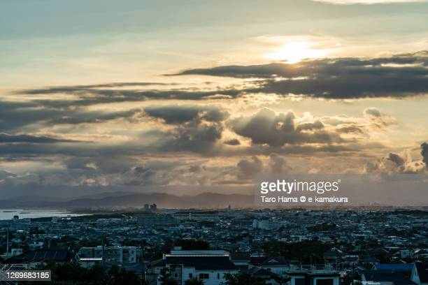 sunset sunbeam on the residential district by the sea in kanagawa prefecture of japan - 平塚市 ストックフォトと画像