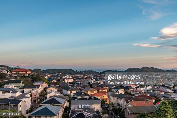 sunset sunbeam on the residential district by the sea in kanagawa prefecture of japan - town foto e immagini stock