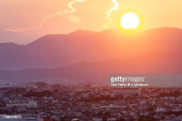 sunset sunbeam on the residential district in japan - chigasaki stock pictures, royalty-free photos & images