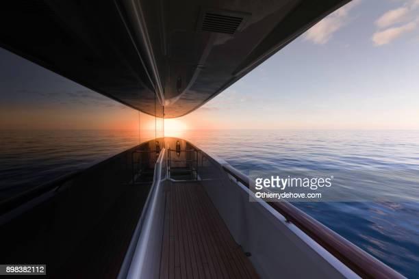 sunset / sunrise on yacht in bahamas - segeljacht stock-fotos und bilder