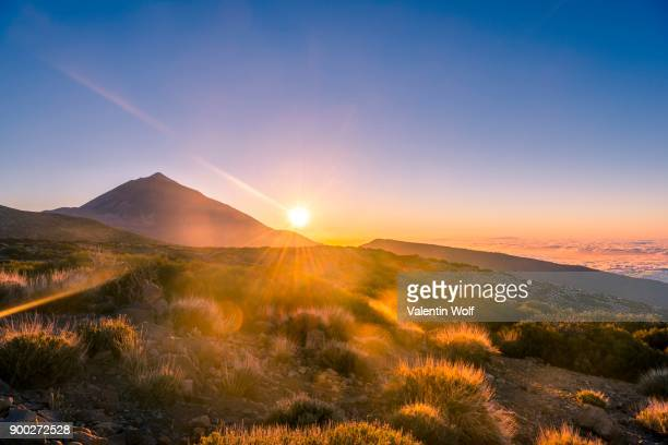 sunset, sunset glow, cloudy sky, volcano teide and volcano landscape, backlit scenery, national park el teide, tenerife, canary islands, spain - pico de teide stock pictures, royalty-free photos & images