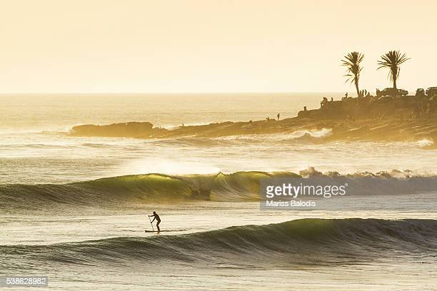 sunset surf session - agadir stock pictures, royalty-free photos & images