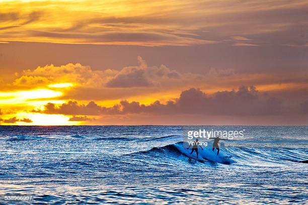 Sunset Surfers Surfing Scenic Hawaiian Ocean off Poipu Beach, Kauai