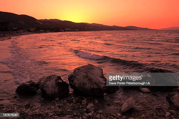 Sunset sweeping beach Porto Zoro Zakynthos