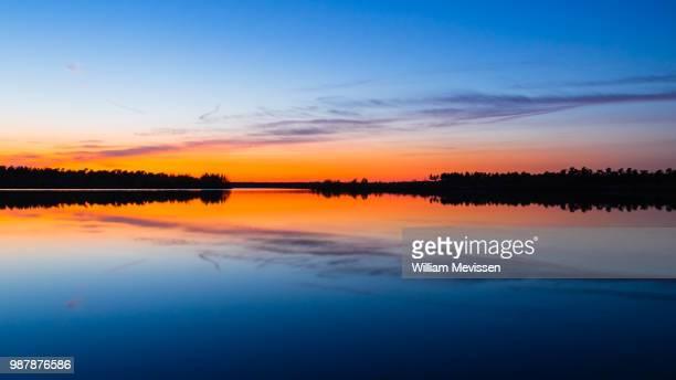 sunset symmetry - william mevissen bildbanksfoton och bilder