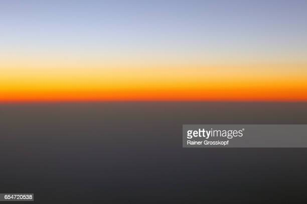 Sunset through an airplane window