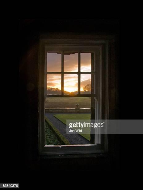 Sunset through open sash window