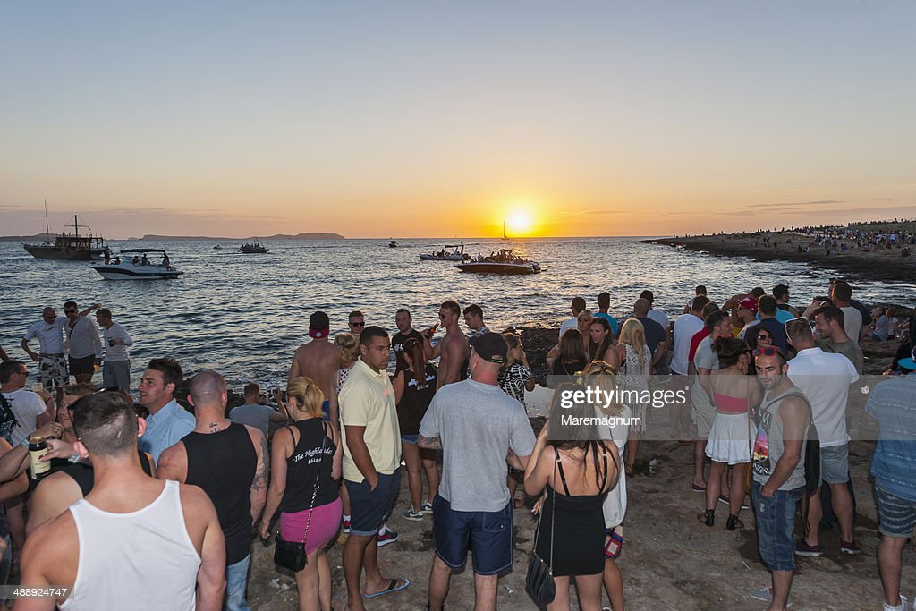 Sunset time along the promenade of café del Mar : Stock Photo