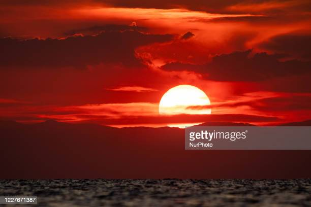 Sunset time at the beach of Paralia Epanomi in Greece on July 16, 2020. Epanomi is located near Chalkidiki popular tourist destination and...