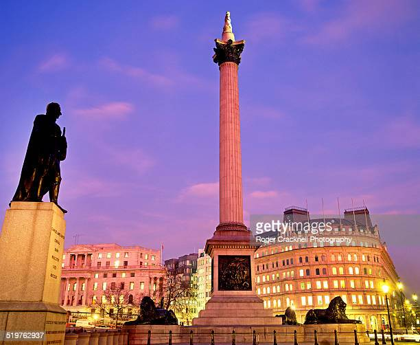 sunset trafalgar square at night london - nelson's column stock photos and pictures