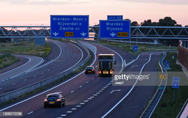 sunset traffic on dutch highway n35 at wierden - small group of objects stock pictures, royalty-free photos & images