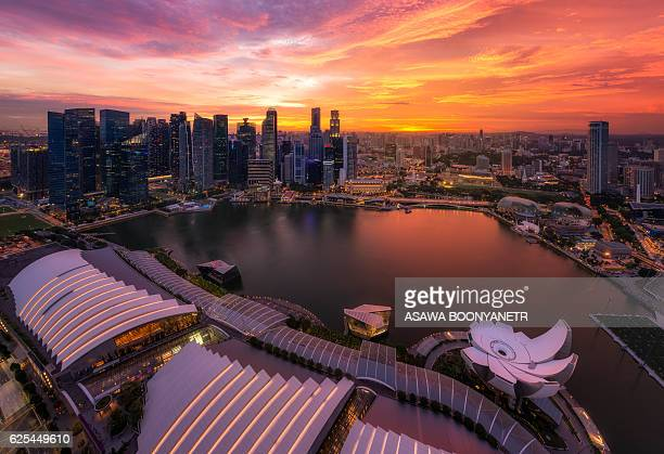 sunset twilight form marina bay sands - marina square stock photos and pictures