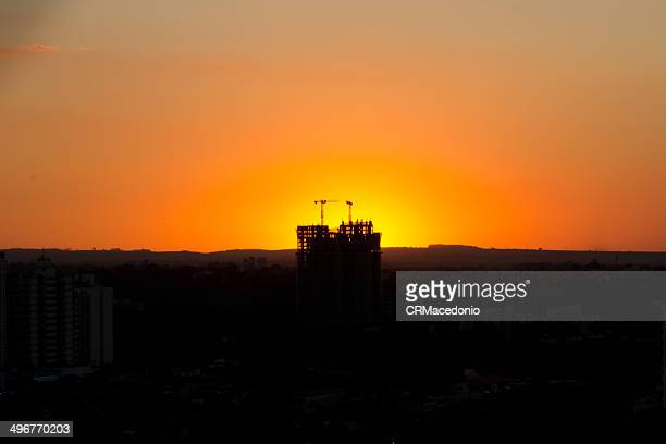 sunset under construction - crmacedonio stock photos and pictures