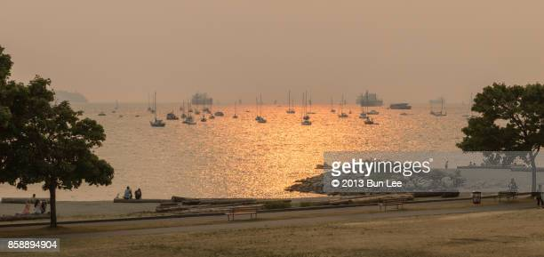 sunset view at english bay - english bay stock photos and pictures