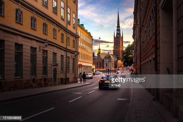 sunset view behind riddarholmen chruch in old town, famous landmark in stockholm city, with tourist and taxi for transportation on road in stockholm city, sweden, europe, scandinavia - stockholm stock pictures, royalty-free photos & images