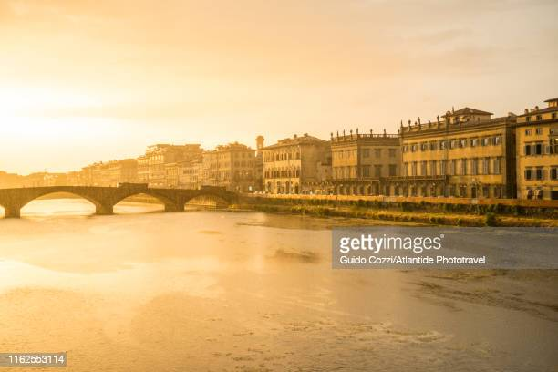 sunset view from ponte santa trinita - image stock pictures, royalty-free photos & images