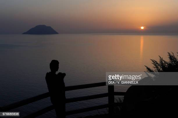 Sunset view from the Belvedere di Stimpagnato with Alicudi in the background Filicudi Aeolian Islands Sicily Italy