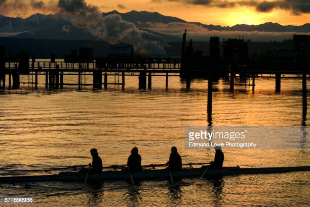 Sunset View of a Rowing Crew in Port Townsend, Washington.