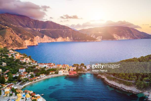 sunset view of asos village on the west coast of kefalonia, greece, europe. aerial view - peninsula de grecia fotografías e imágenes de stock