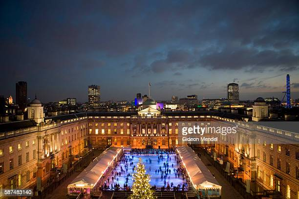 A sunset view of at the Somerset House Ice Rink with its huge Tiffany sponsored Christmas Tree Since opening in 2000 it has been acknowledged around...