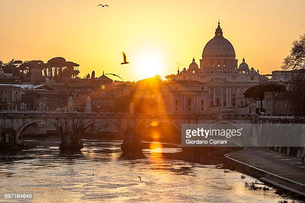 Sunset view of Basilica St. Peter and river Tiber