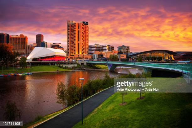 sunset view of elder park, the riverside precinct and the torrens lake, adelaide, south australia - adelaide stock pictures, royalty-free photos & images
