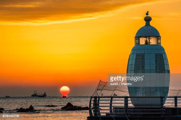 Sunset view of lighthouse in Songjeong Beach