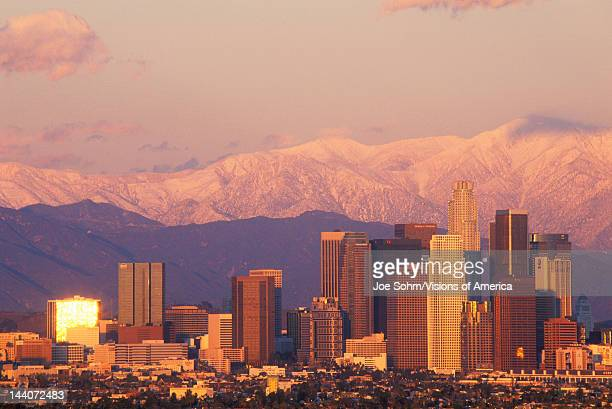 Sunset view of Mount Baldy and Los Angeles from Baldwin Hills the day after a winter storm Los Angeles California