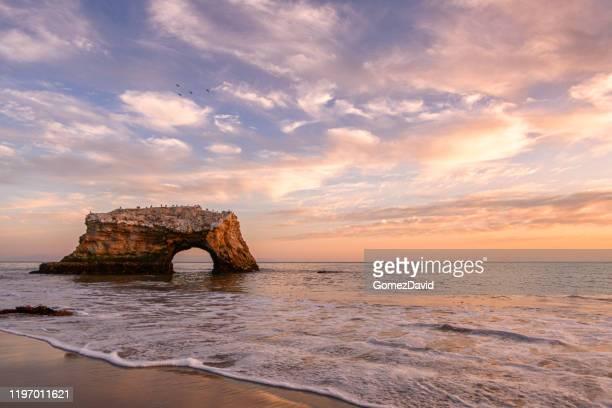 sunset view of natural bridges rock formation - romantic sunset stock pictures, royalty-free photos & images